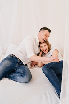 Young couple portrait. beautiful pretty woman kissing handsome man. sensual photo