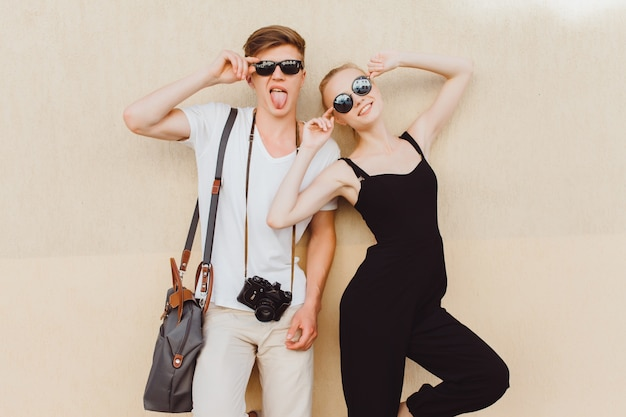 Young couple posing making a fool