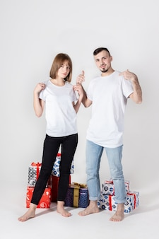 Young couple posing with christmas gifts