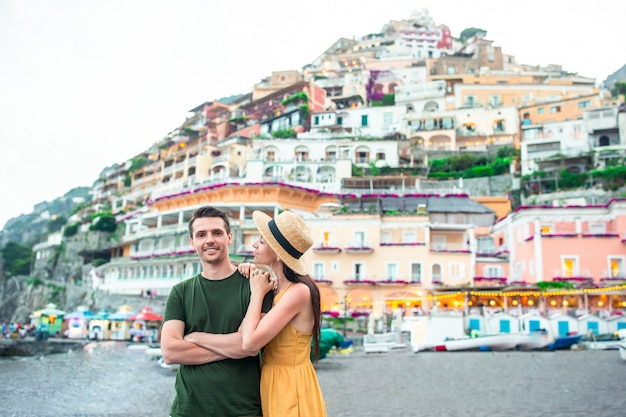 Young couple in positano village on the background,