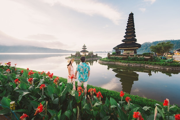 Young couple  at the pura ulun danu bratan, bali