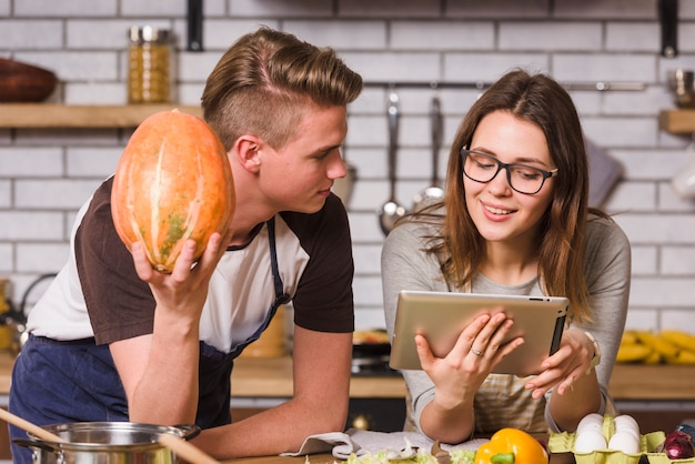 Young couple reading recipe together