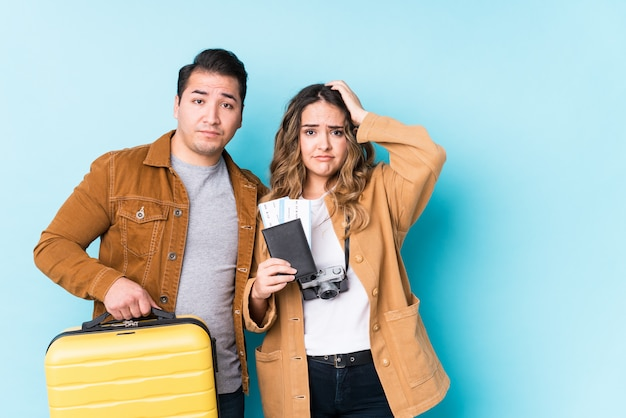 Young couple ready for a travel isolated being shocked, she has remembered important meeting.