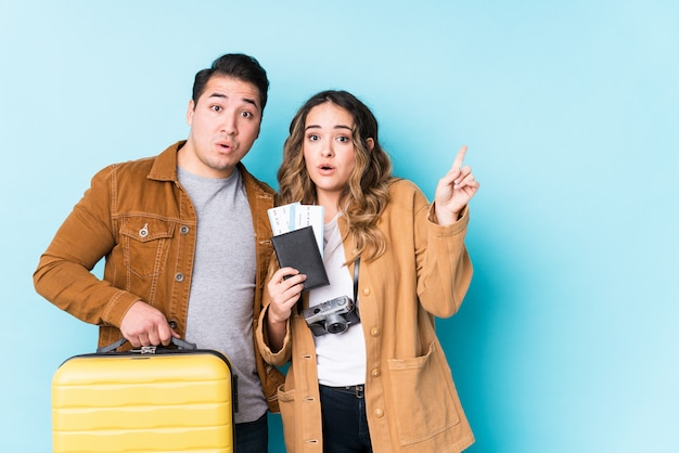 Young couple ready for a travel isolated having some great idea, concept of creativity.