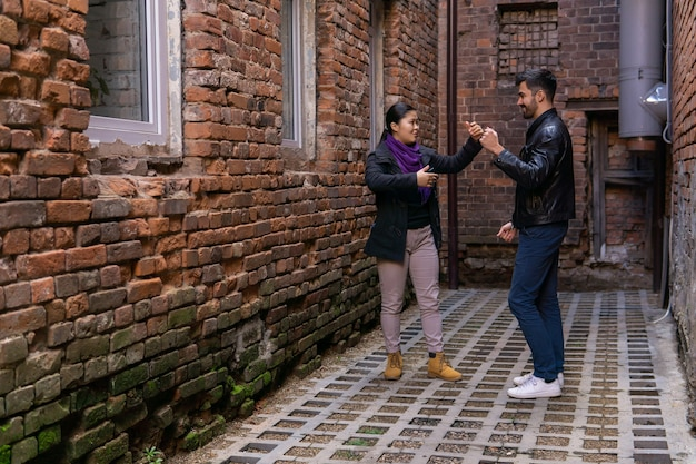Young couple rehearsing a dance in the old alley