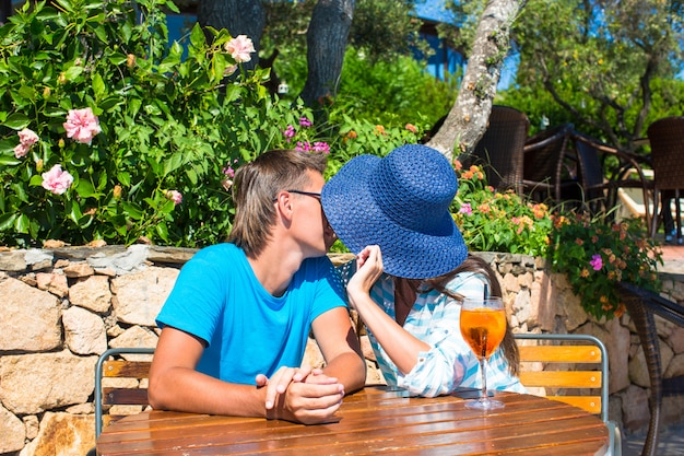 Young couple relaxing in outdoor cafe