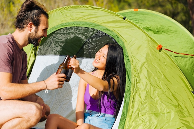 Young couple relaxing in tent