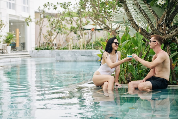 Young couple resting in swimming pool