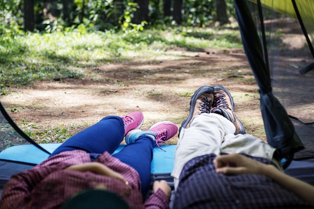 Young couple resting in tent
