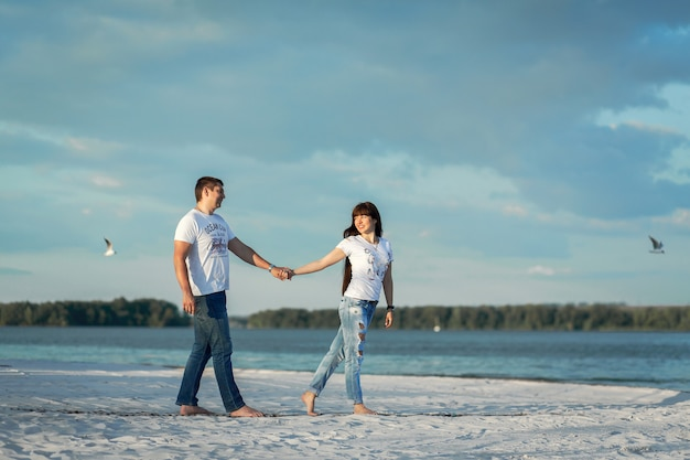 Young couple romantic date at sand beach.