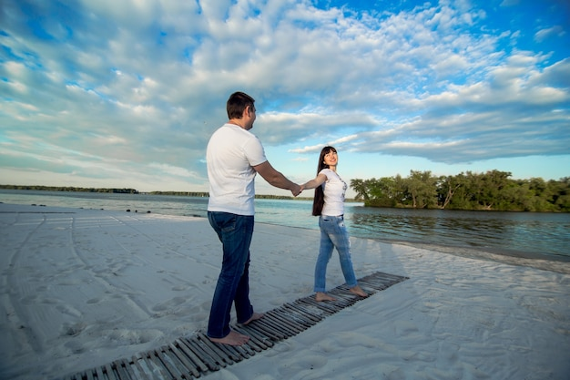 Young couple romantic date at sand beach