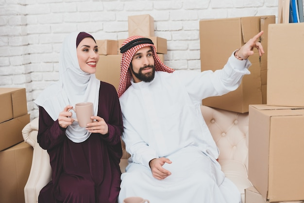 Young couple of saudi arabs got housing new home.