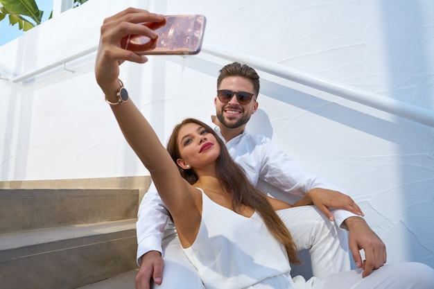 Young couple selfie photo with smarphone