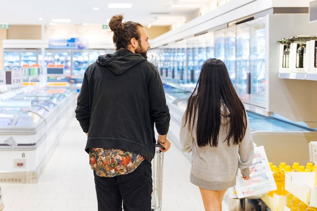 Young couple on shopping in supermarket