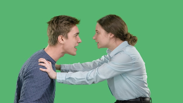 A young couple shouts at each other, a quarrel and a scandal, a girl pushes her young man away