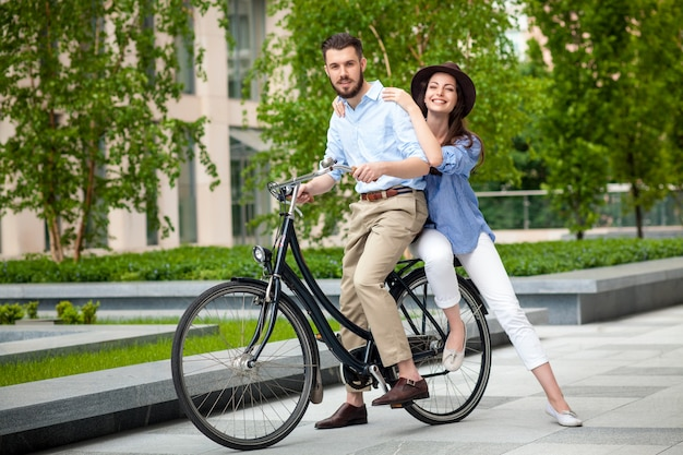 Young couple sitting on a bicycle