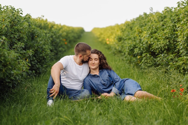 Young couple sitting on grass and relaxing