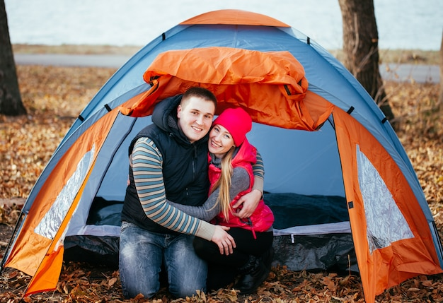 Young couple sitting in a tent camping