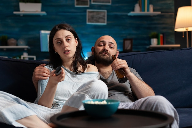 Young couple spending evening together dressed in pajamas enjoying spending time together