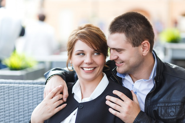 Young couple spends time in cafe