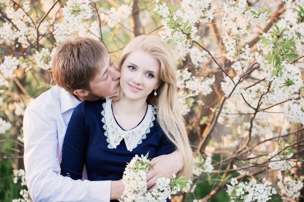 Young couple in spring garden