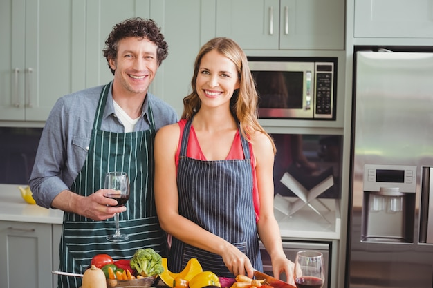 Young couple standing in a kitchen