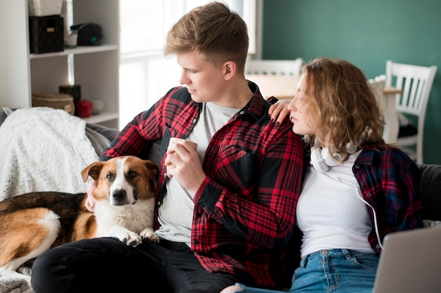 Young couple staying with dog