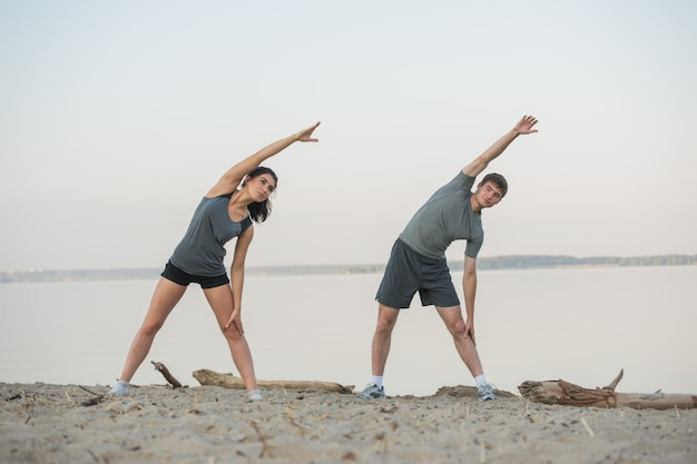 Young couple stretching