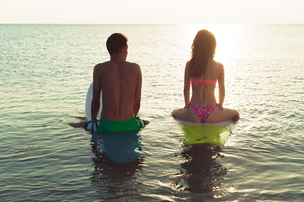 Young couple of surfers