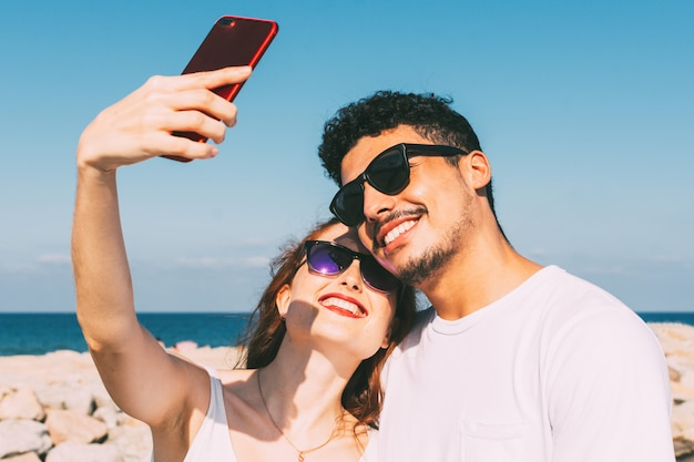 Young couple take a selfie with their smartphone