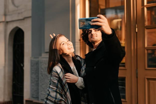 Young couple takes a selfie outdoors in autumn