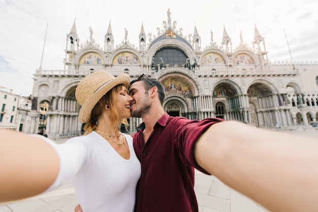 Young couple taking a selfie in a city