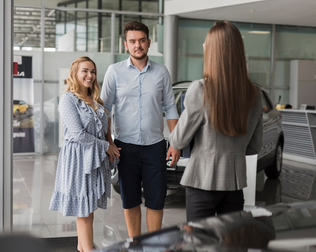 Young couple talking with a showroom agent