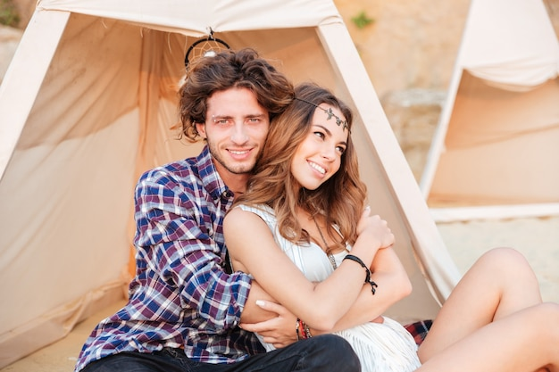 Young couple in teepee on the beach