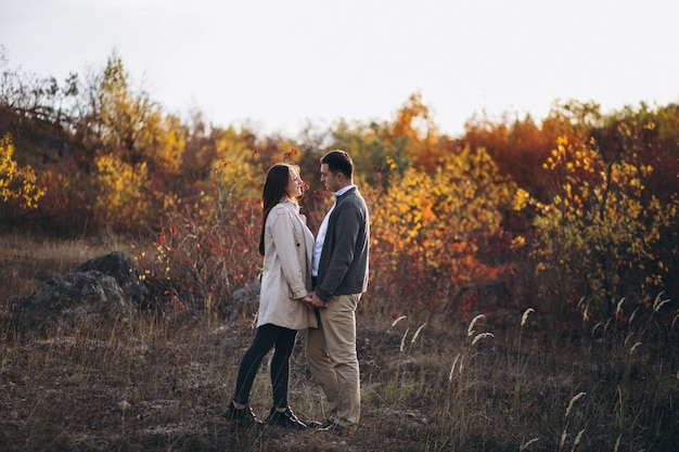 Young couple together in an autumn nature