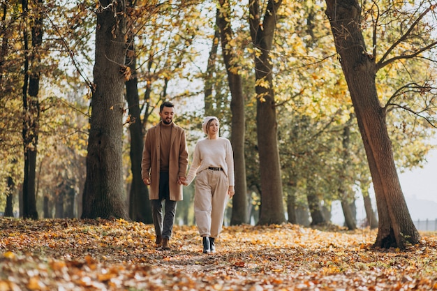 Young couple together in an autumn park