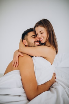 Young couple together lying in bed