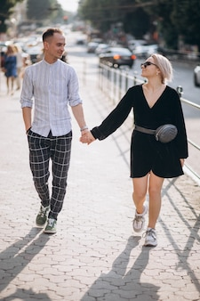 Young couple together in town