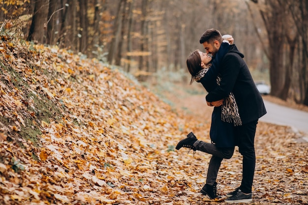 Young couple together walking in an autumn park