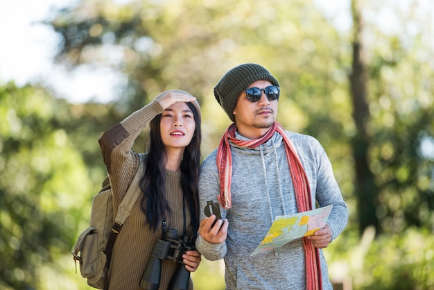 Young couple tourist travel in mountain forest