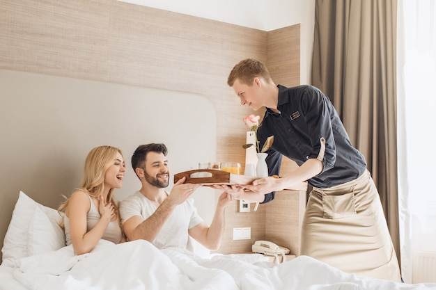 Young couple travel together hotel room leisure