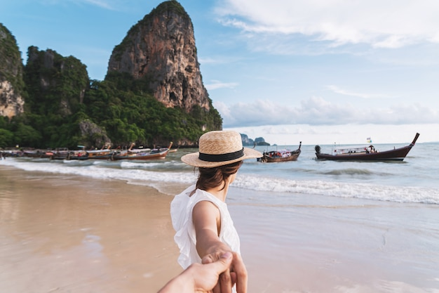 Young couple traveler enjoying a summer vacation at tropical sand beach in krabi, thailand