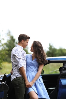 Young couple traveling by car