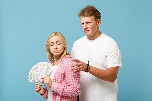 Young couple two friends guy and woman in white pink blank t-shirts posing
