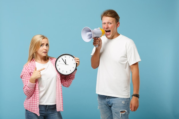 Young couple two friends guy and woman in white pink empty t-shirts posing