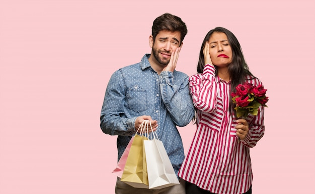 Young couple in valentines day desperate and sad