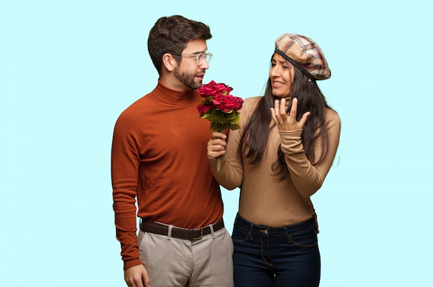 Young couple in valentines day very scared and afraid