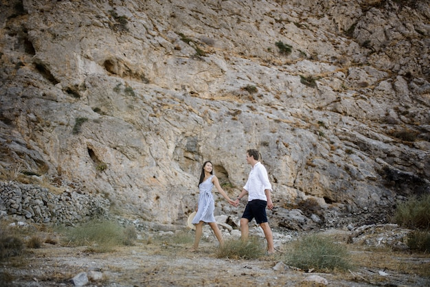 Young couple walking in the mountains