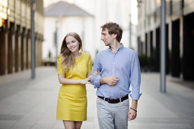 Young couple walking together in a city