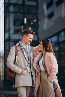 Young couple walking together in town